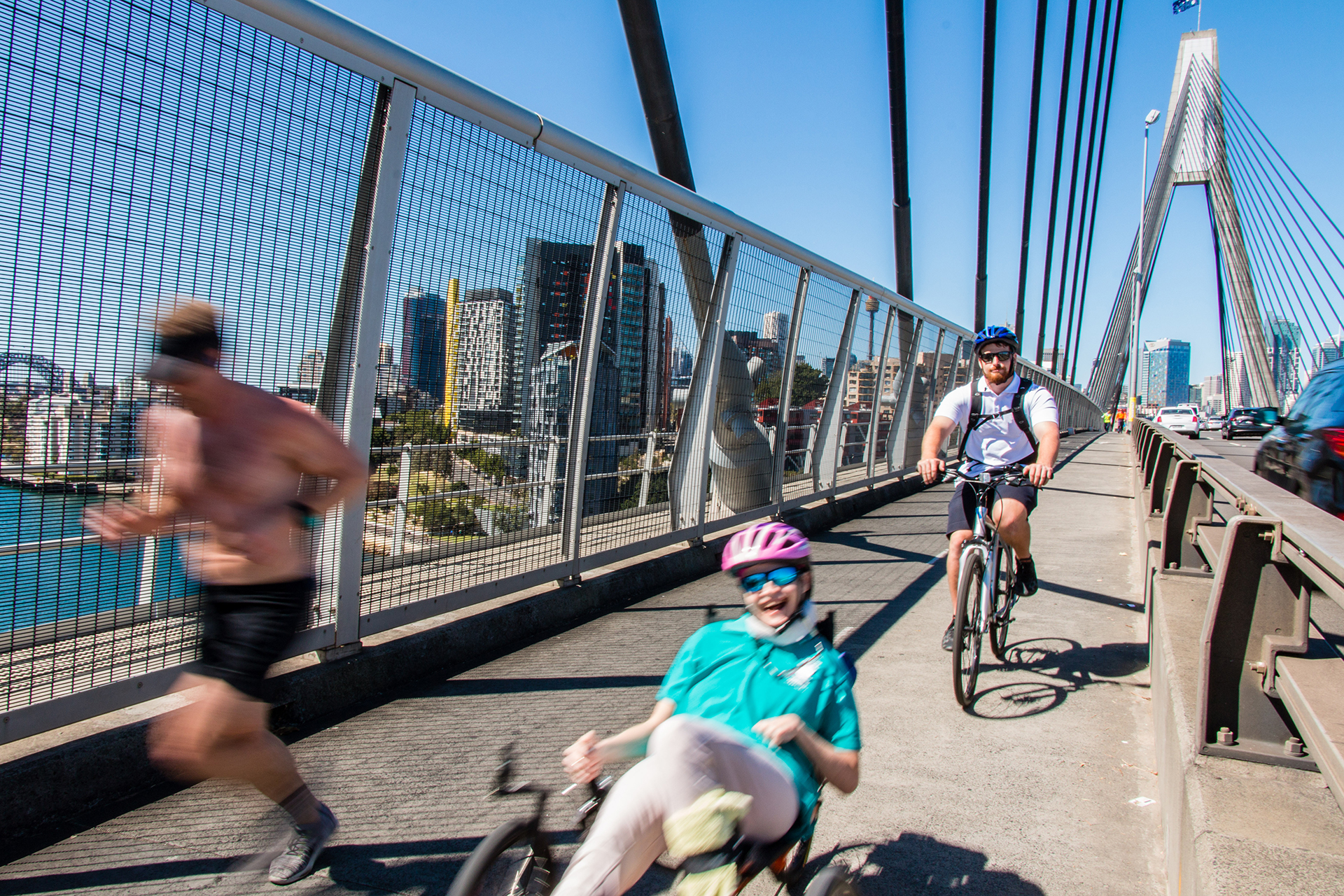 client cathering cycling across anzac bridge with rec therapist