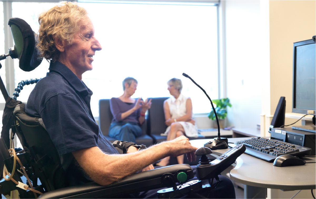 patient in Spinal Injury Unit using computer